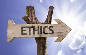 Ethics wooden sign on a beautiful day-1