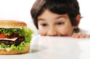 Kid and hamburger